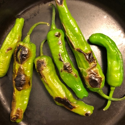 Shishitos in the pan